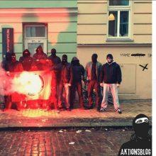 Nazis posieren am 18. Dezember vor der Szenekneipe und verbrennen eine Antifa-Fahne