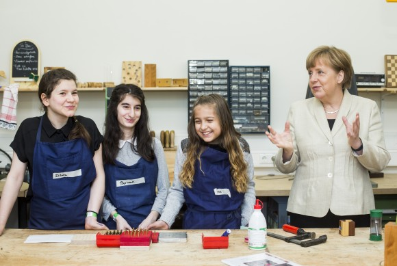 BERLIN, GERMANY - MAY 12:  German Chancellor Angela Merkel meets student from the Roentgen school in on May 12, 2015 in Berlin, Germany.  Merkel visited the school as part of a European Union Project Day to discuss pan-European issues with students, especially as regards to the future of Europe's youth. (Photo by Jochen Zick - Pool /Getty Images