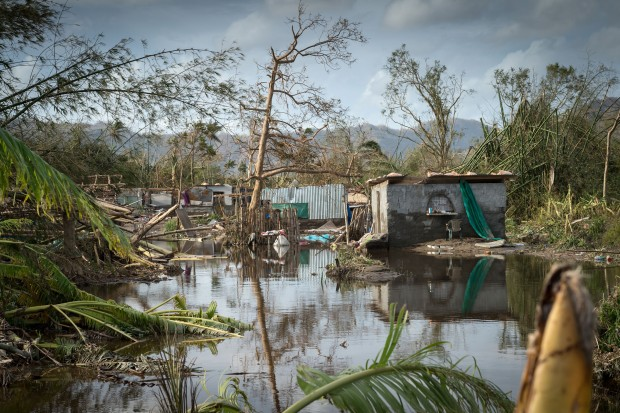 PORT VILA, VANUATU - MARCH 16: In this handout image provided by the New Zealand Defence Force, scenes of devastation in the area around Port Vila on March 16, 2015 in Port Vila, Vanuatu. Two New Zealand Defence Force (NZDF) C-130 Hercules aircraft from No. 40 Squadron, Royal New Zealand Air Force (RNZAF), arrived in Vanuatu with consignments of aid for the stricken country in the wake of Tropical Cyclone Pam. The Category 5 storm hit late night on March 13, causing widespread damage in the archipelago nation of Vanuatu, located about 1,750 kilometres east of northern Australia in the South Pacific Ocean. Officials have said that nine out of 10 of the country's buildings have been destroyed, according to published reports. (Photo by MR Roderick J. Mackenzie/New Zealand Defence Force via Getty Images)
